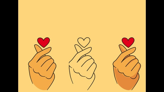 Among many Korean trends that caught interest, the finger heart is a gesture that is the most popular (Shutterstock)