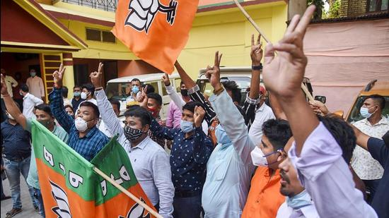 Activists of the BJP celebrate after getting the majority in the Assam state assembly elections in Guwahati on Sunday, May 2. (PTI)