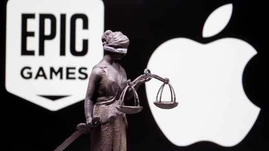 3D printed Lady Justice figure is seen in front of displayed Apple and Epic Games logos in this illustration photo taken February 17, 2021. (REUTERS)