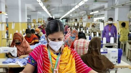 A woman works in a garment factory in Dhaka, Bangladesh (Reuters)