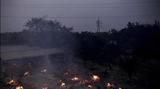 Funeral pyres of Covid-19 fatalities burn during a mass cremation at a crematorium in New Delhi, India, on Friday. (Bloomberg)
