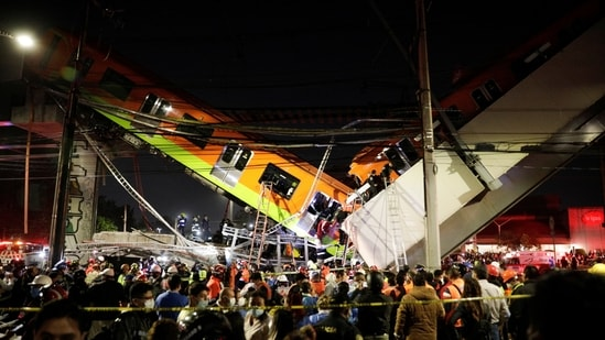 Rescuers work at a site where an overpass for a metro partially collapsed with train cars on it at Olivos station in Mexico City, Mexico.(REUTERS)