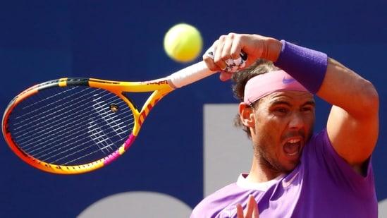 Rafael Nadal returns the ball to Stefanos Tsitsipas of Greece.(AP)