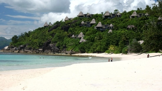 A general view shows tourists on the sandy beaches outside the Seychelles capital Victoria. (REUTERS)