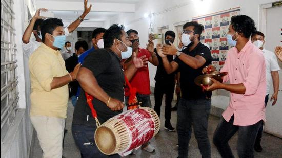 Activists of Asom Gana Parishad (AGP) allied with BJP celebrate after crossing the halfway mark during counting day of Assam assembly election in Guwahati on Sunday, May 2. (File photo)