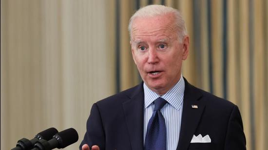 US President Joe Biden delivers remarks on the state of the coronavirus disease vaccinations from the State Dining Room at the White House in Washington, DC, US, on Tuesday. (REUTERS)