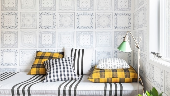 This image released by Portland Oregon-based interior designer Max Humphrey shows a room with a wallpaper design inspired by bandanas. (AP)