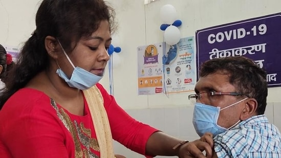 An elderly person being administered the Covid-19 vaccine at Sadar Hospital in Dhanbad in Jharkhand.(HT file photo)