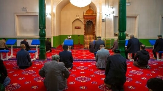Uyghurs and other members of the faithful pray during services at the Id Kah Mosque in Kashgar in western China's Xinjiang Uyghur Autonomous Region, as seen during a government organized visit for foreign journalists on April 19, 2021. Under the weight of official policies, the future of Islam appears precarious in Xinjiang, a remote region facing Central Asia in China's northwest corner. Outside observers say scores of mosques have been demolished, which Beijing denies, and locals say the number of worshippers is on the decline. (AP)