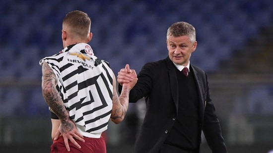 Manchester United manager Ole Gunnar Solskjaer shakes hands with AS Roma's Rick Karsdorp after the match.(REUTERS)