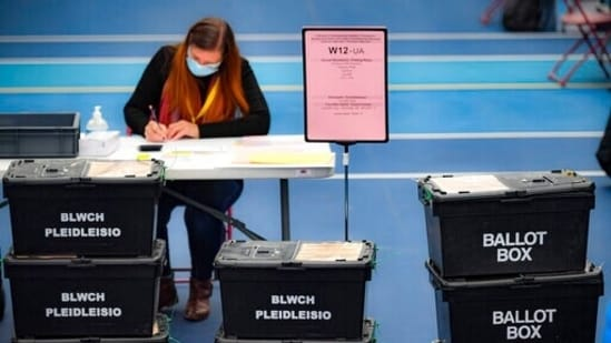 Ballot boxes arrive for counting votes for the Welsh Parliamentary Elections at the Cardiff House of Sport, Cardiff, Wales.(AP)