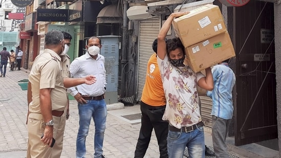 While 96 oxygen concentrators were seized from Khan Chacha, another nine were found illegally stored at Town Hall. In picture - Police personnel in a raid at Khan Chacha restaurant in New Delhi.(PTI)
