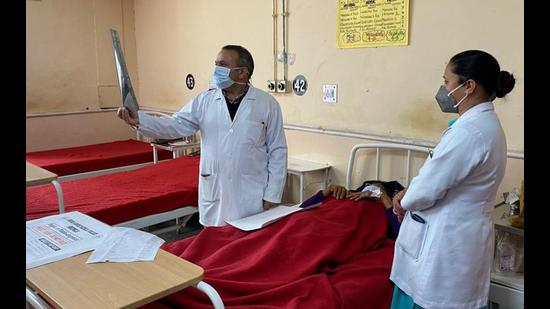 A doctor checking reports at Indira Gandhi Medical College and Hospital in Shimla. (HT file photo)