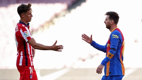 FC Barcelona's Lionel Messi with Atletico Madrid's Marcos Llorente after the match.(REUTERS)