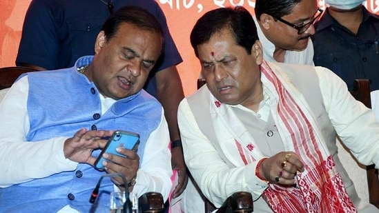Assam BJP leader Himanta Biswa Sarma interacts with Sarbananda Sonowal during the recently concluded Assam assembly polls. (ANI file PHOTO.)