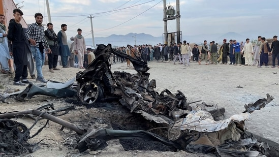 People stand at the site of a blast in Kabul, Afghanistan.(REUTERS)