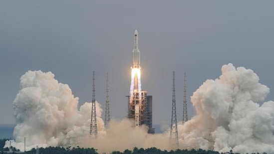 FILE PHOTO: The Long March-5B Y2 rocket, carrying the core module of China's space station Tianhe, takes off from Wenchang Space Launch Center in Hainan province, China April 29, 2021. China Daily via REUTERS