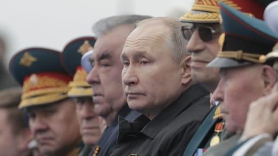Russian President Vladimir Putin and Tajik President Emomali Rakhmon attend a military parade on Victory Day.(Reuters)