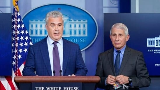 White House Covid-19 Response Coordinator Jeff Zients, left, speaks alongside Dr Anthony Fauci during a press briefing.(AP)