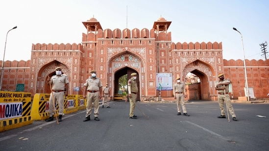 Police personnel stand guard outside the historic Sanganeri Gate after announcement of a lockdown, in Jaipur, Sunday, May 9, 2021. (PTI)