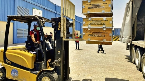 A driver loads the medical supplies, which will be sent to India, at the International Humanitarian City in Dubai on Sunday.(Reuters)