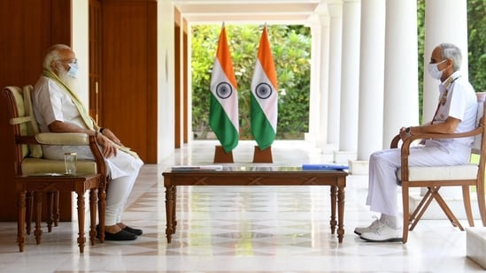 Prime Minister Narendra Modi interacts with Chief of Naval Staff Admiral Karambir Singh to discuss initiatives taken by Indian Navy to tackle coronavirus pandemic situation in the country. (File photo)
