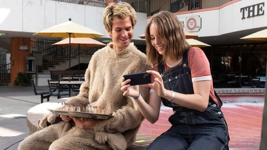 This image released by IFC Films shows Andrew Garfield, left, and Maya Hawke in a scene from Mainstream, a film by Gia Coppola. (Beth Dubber/IFC Films via AP)(AP)