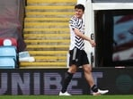 Manchester United's Harry Maguire leaves the pitch after sustaining an injury(Pool via REUTERS)