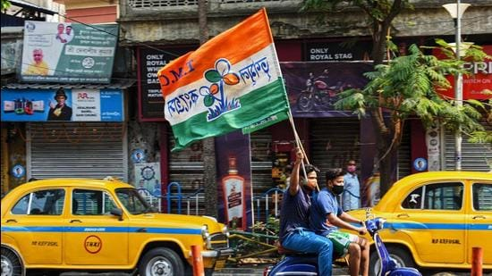 TMC supporters celebrate their party's lead in the West Bengal state legislative assembly elections on May 2. (File photo)