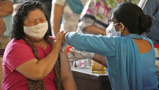 A woman receives a dose of Covid-19 vaccine. (Photo by Parveen Kumar/Hindustan Times)