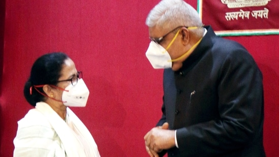 West Bengal Chief Minister Mamata Banerjee interacts with Governor Jagdeep Dhankar during the swearing-in ceremony of the new minister of the State, at the Raj Bhavan, in Kolkata on Monday. (ANI Photo)