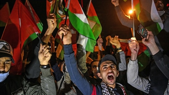 Protesters hold Palestine and Turkish national flags and chant slogans during a demonstration against Israel in front of the Israeli Consulate in Istanbul.(AFP)