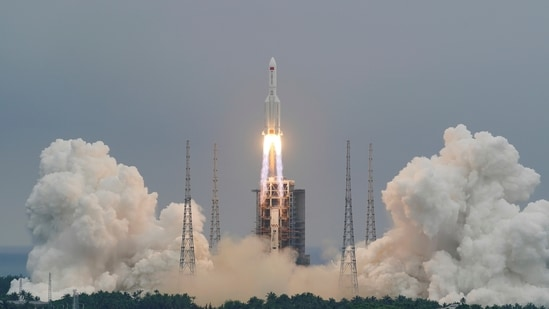FILE PHOTO: The Long March-5B Y2 rocket, carrying the core module of China's space station Tianhe, takes off from Wenchang Space Launch Center in Hainan province, China.( REUTERS)