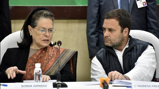 New Delhi, India- Dec 22, 2017: Congress Party President Rahul Gandhi, talking with Former President Sonia Gandhi during the Congress Working Committee ( CWC ) meeting at AICC in New Delhi, India on Friday, December 22, 2017. ( Photo by Sonu Mehta/ Hindustan Times) (Sonu Mehta/HT PHOTO)