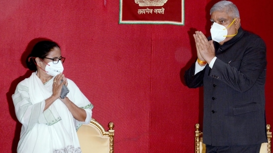 West Bengal chief minister Mamata Banerjee greets governor Jagdeep Dhankar during the swearing-in ceremony of the new minister, at the Raj Bhavan in Kolkata on Monday.(ANI Photo)