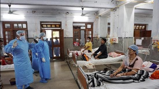 Doctors attend to patients in KanpurMay 8, 2021. The process of medical management of Covid-19 is under great strain. Testing is hard, hospital admissions of patients with serious symptoms (with or without a test) are harder, there is an acute shortage of medical supplies, contact-tracing is non-existent, bureaucratic red tape has made care even more difficult, and there is little dignity in death. (PTI)