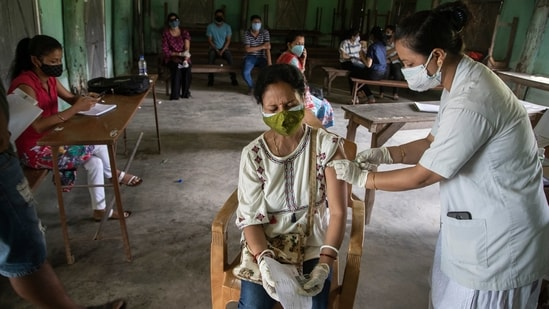 An Indian woman is injected with a dose of COVAXIN as she gets vaccinated against the coronavirus in Gauhati, Assam.(AP)