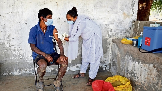 A person getting vaccinated in rural Gujarat.(Reuters)