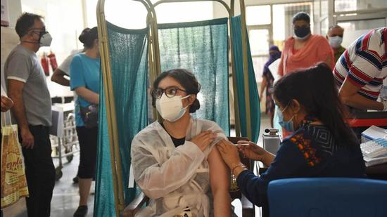 A beneficiary being inoculated against Covid-19 at the Sector 31 Polyclinic in Gurugram on Tuesday, May 11. (Vipin Kumar /HT photo)