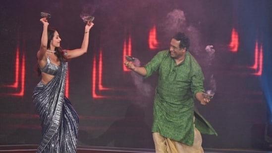 Malaika Arora and Anurag Basu on the sets of Super Dancer 4.