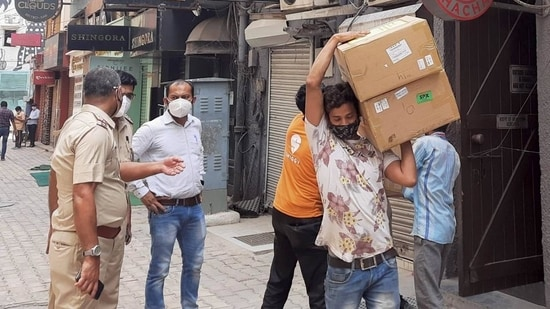 Police personnel during a raid at Khan Chacha restaurant in New delhi, in which boxes of oxygen concentrators were recovered.(PTI File Photo)