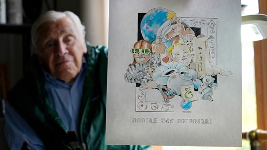 Artist Robert Seaman holds up the 365th daily doodle sketch in his room at an assisted living facility, (AP)