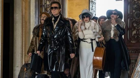 "This image released by Netflix shows David Pittu as Joe Eula, from left, Ewan McGregor as Halston, Krysta Rodriguez as Liza Minnelli and Rebecca Dayan as Elsa Peretti in a scene from ""Halston."" A new series about the fashion designer premieres Friday on Netflix. (AP)"