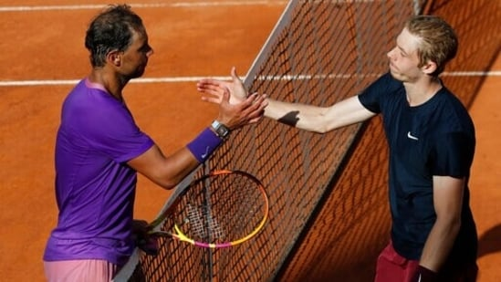Spain's Rafael Nadal, left, shakes hands with Canada's Denis Shapovalov,at the end of their 3rd round match at the Italian Open tennis tournament.(AP)