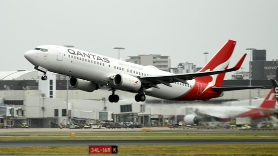 A Qantas plane takes off from the Sydney International airport.(AFP)