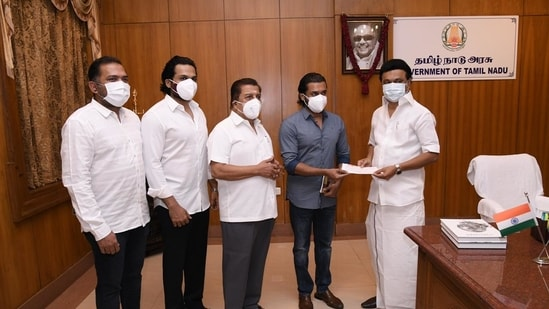 Suriya with his father actor Sivakumar and brother, actor Karthi with chief minister of Tamil Nadu, MK Stalin.