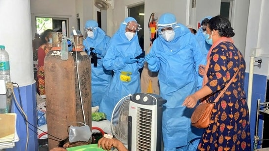 Goa chief minister Pramod Sawant (right), wearing a personal protective equipment suit, speaks to Covid-19 patients at the Goa Medical College and Hospital.
