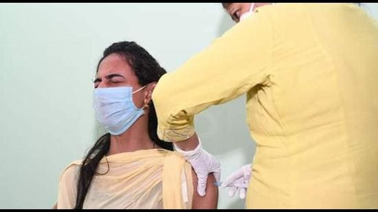 A member of the transgender community getting vaccinated for Covid-19 as part of a special drive in Guwahati on Friday. (PHOTO: SOURCED.)