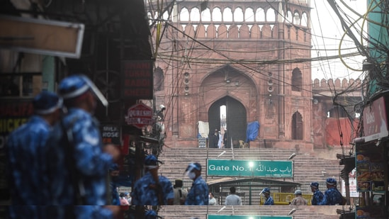 Paramilitary personnel stand guard outside Jama Masjid during Eid-al-Fitr festival amid a Covid-19 induced lockdown, in New Delhi, India, on Friday, May 14, 2021. (Photo by Amal KS/ Hindustan Times)