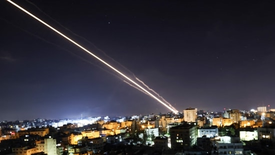 Rockets are launched from Gaza City, controlled by the Palestinian Hamas movement, towards Israel early on May 15, 2021.(AFP)